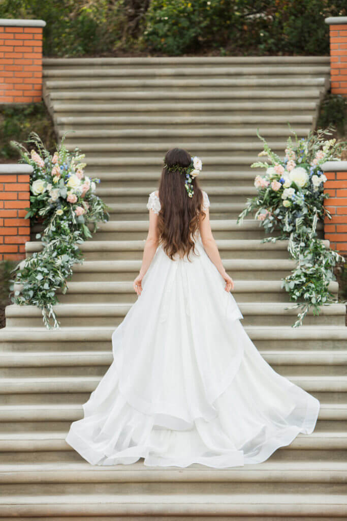 Wedding dress on the steps of Quail-Ranch