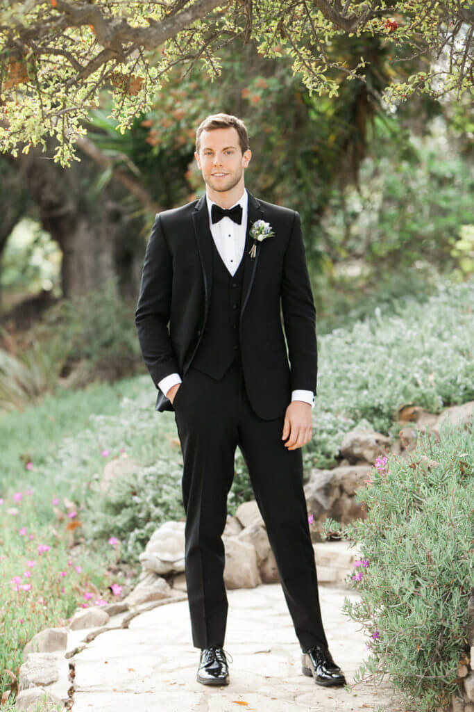 portrait of groom with a black tux