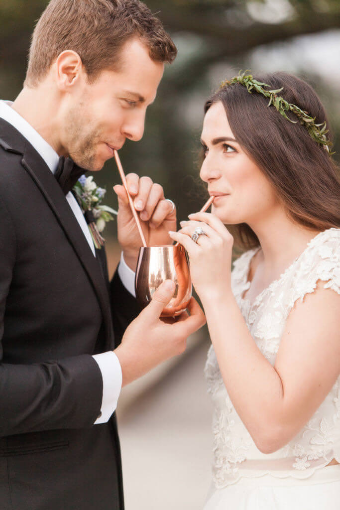 Bride and groom drinking out of a Mule cup.