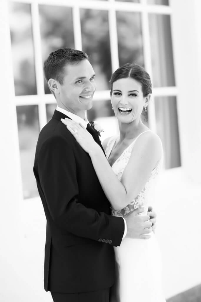 Couple laughing at Quail Ranch after getting married.