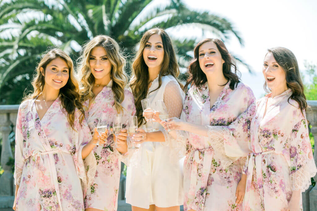 Christina and her bridesmaids sipping Crystal champagne at her wedding day