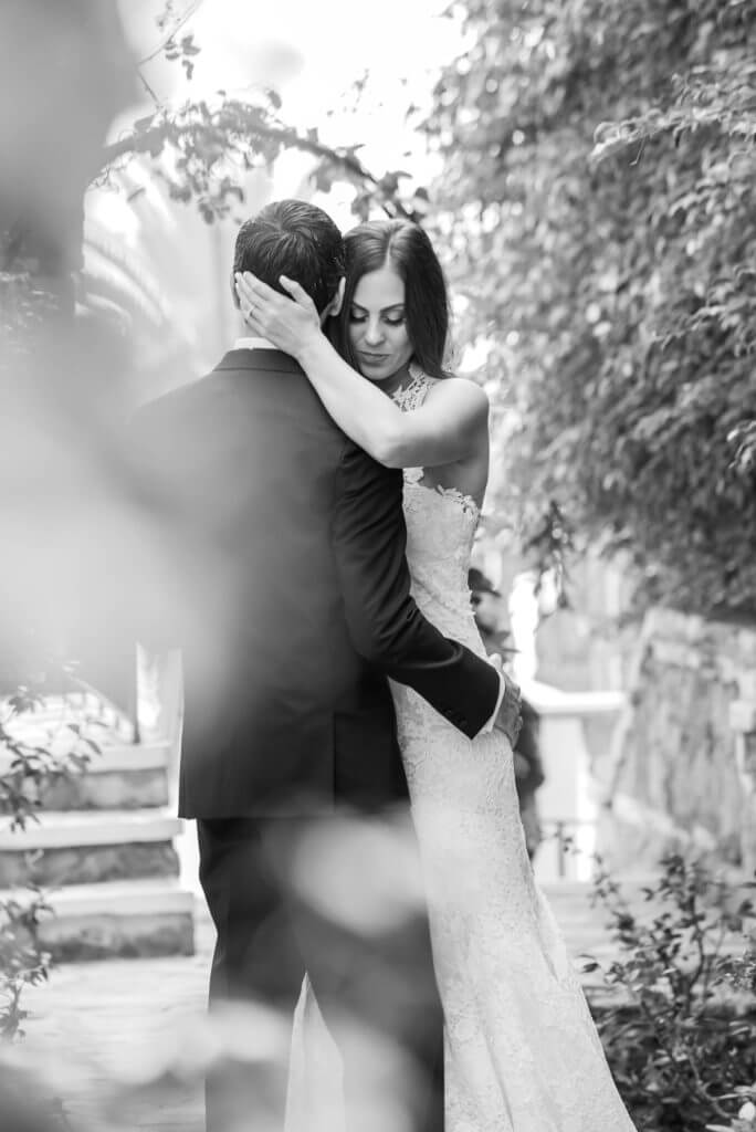 a quiet moment husband and wife kissing black and white portrait