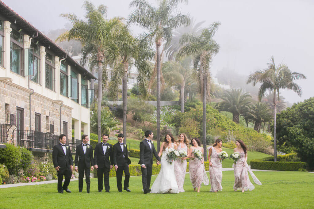 bridal party in front of pacific ocean