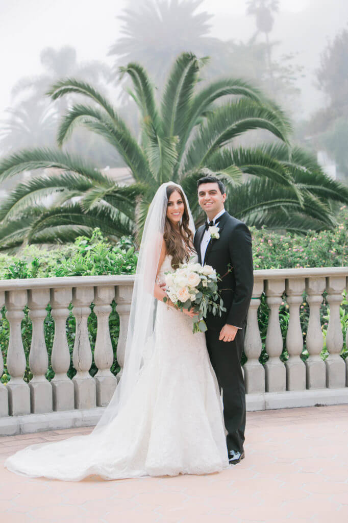 Classic portrait of a bride and groom balcony at Bel air bay club