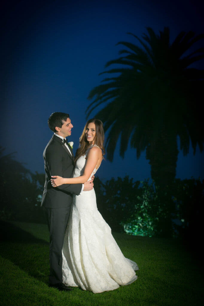 Night Portrait of Christina and MichelAngelo at Bel Air bay club lawn area.
