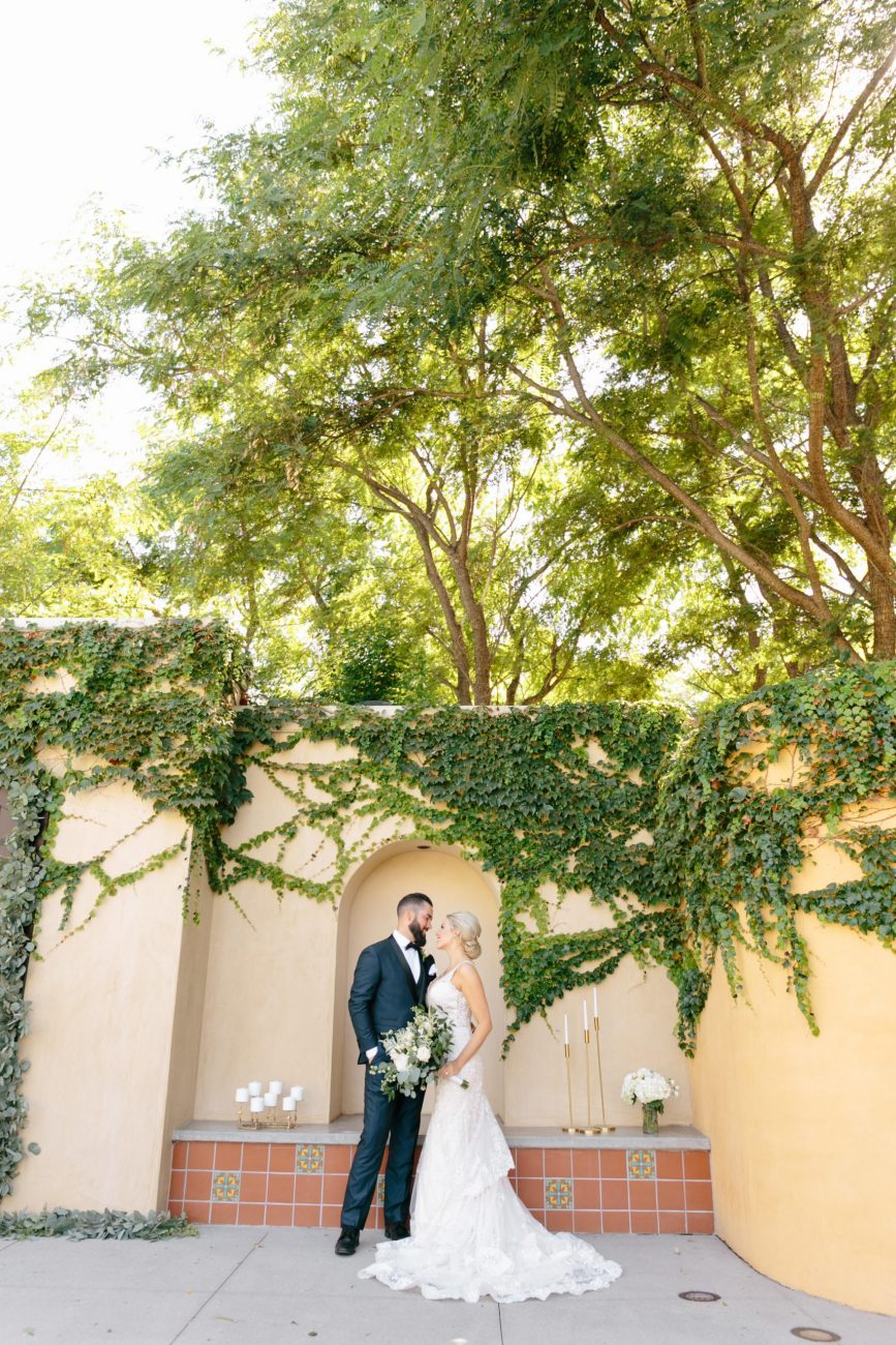 bride and groom standing at Los Robles green